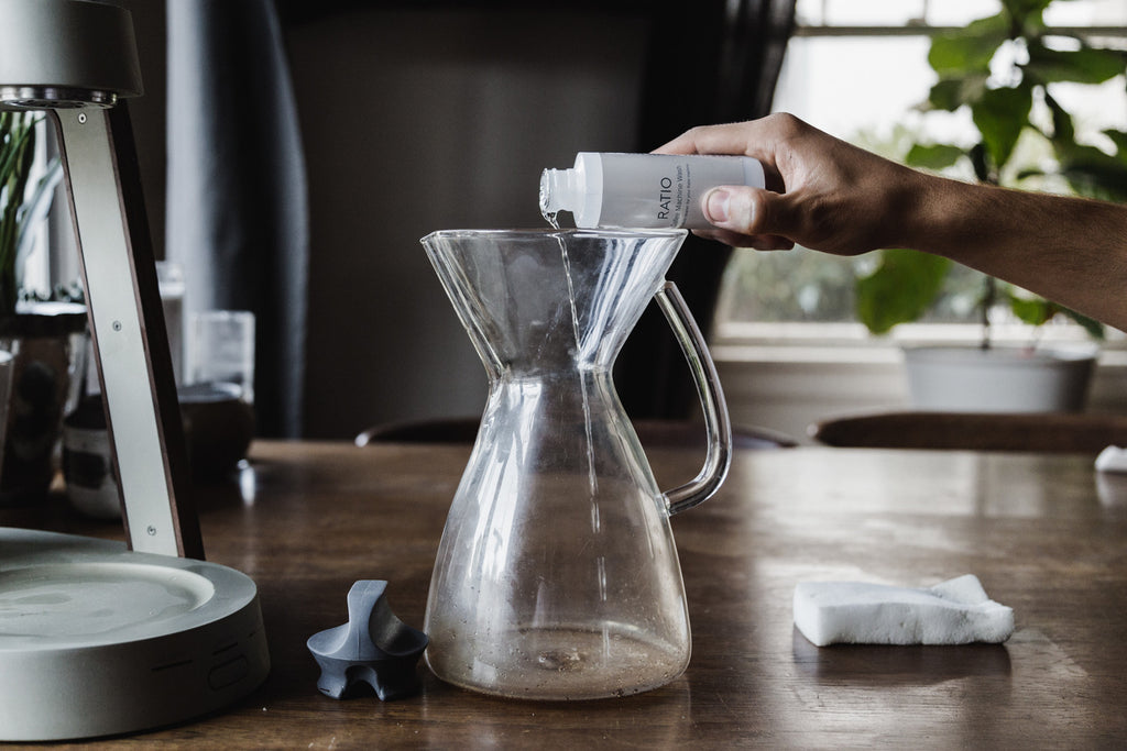 Pouring liquid wash into the carafe