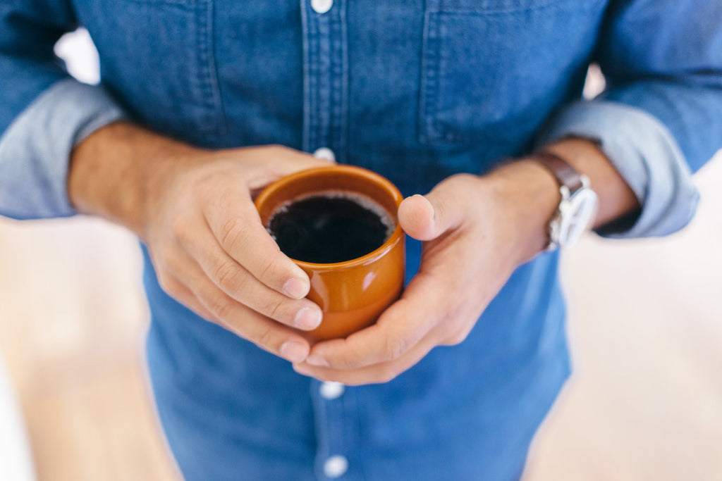Somebody holding a cup of coffee