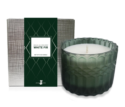 White Fir Eco-Luxury Scent poured into a beautiful patterned green glass jar and packaged in a silver recyclable box.