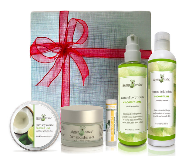 Ultimate Coconut Lime Gift Box Set with tin candle, face moisturizer, lip balm, body wash and lotion packaged in a silver box with a bow