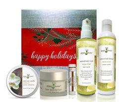 Organic vanilla & pear ultimate holiday gift set with tin candle, face moisturizer, lip balm, body wash and body lotion.
