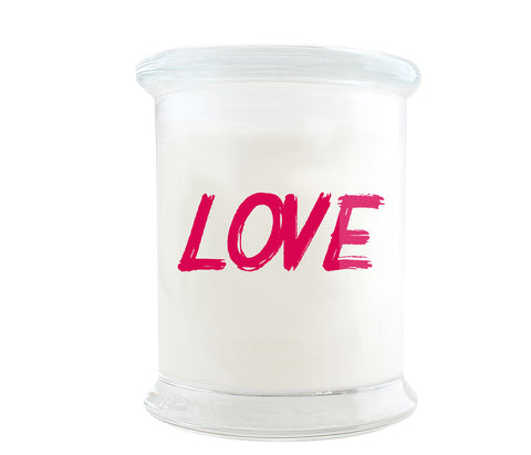 Eco-Luxury Candle with words LOVE in hot pink printed on the glass jar