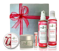 Organic peppermint & eucalyptus ultimate gift box with tin candle, face moisturizer, lip balm, body wash, and body lotion