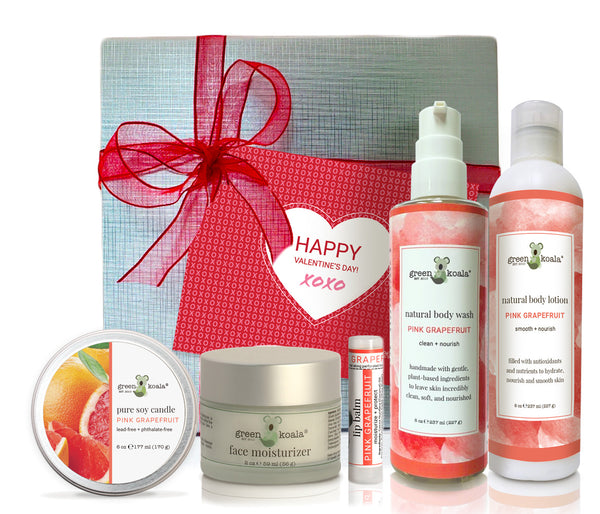 Organic pink grapefruit ultimate valentine'sgift box with tin candle, face moisturizer, lip balm, body wash and body lotion.