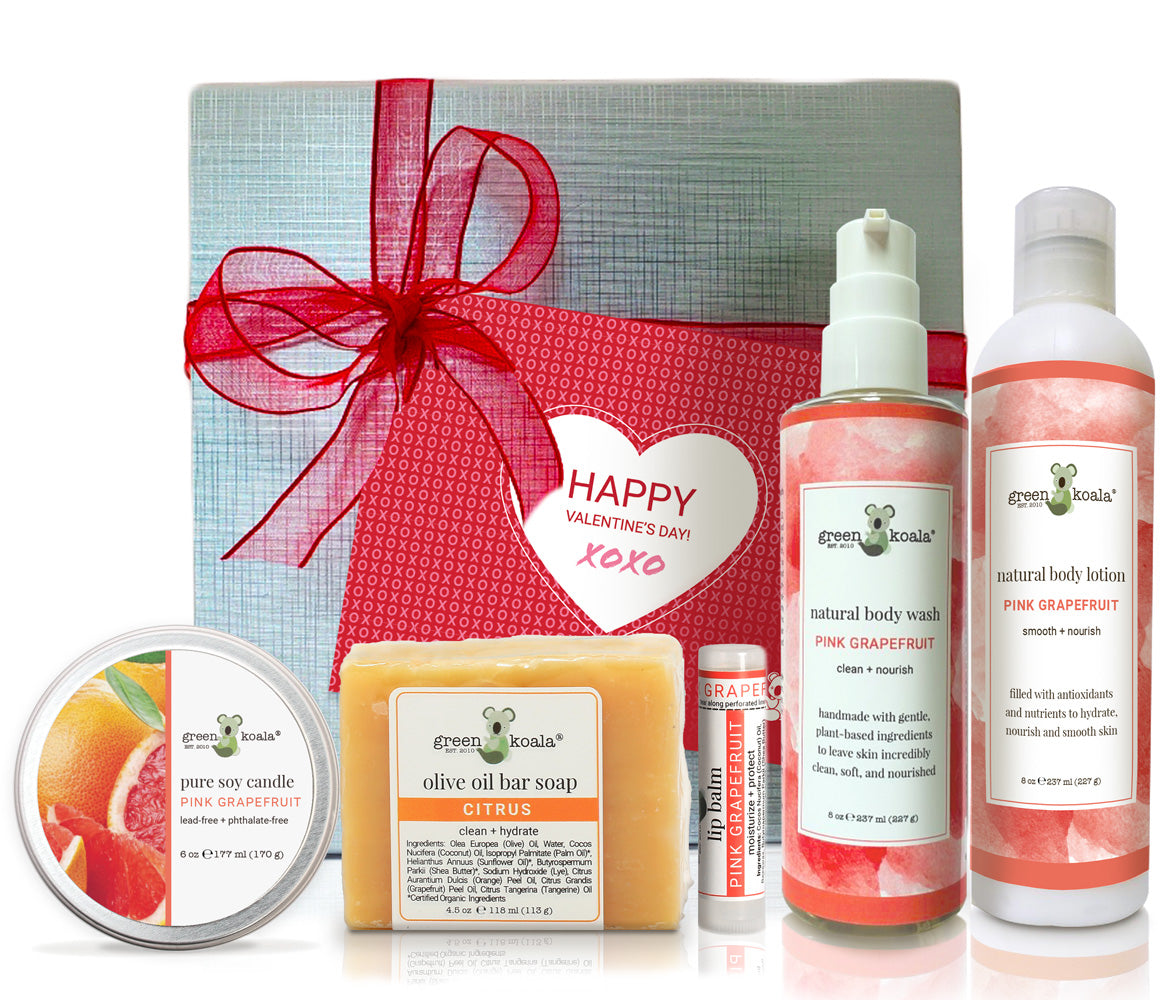 Pink Grapefruit Valentine's Gift Box Set with tin candle, citrus bar soap, lip balm, body wash and lotion packaged in a silver box with red bow and happy valentine's day card