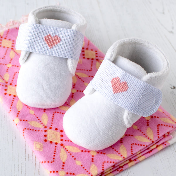 Make a pair of cross stitched baby slippers