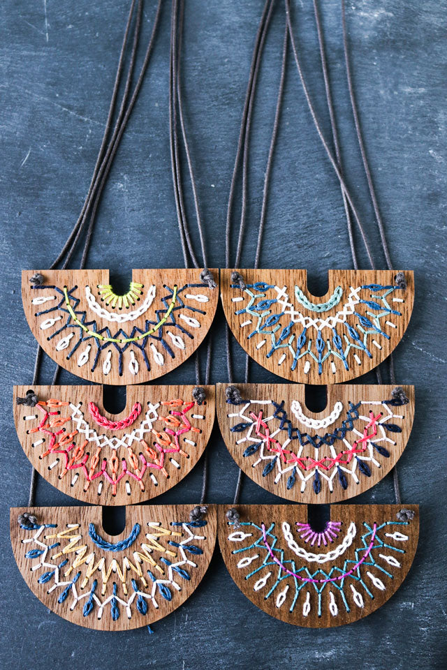 Walnut wood embroidered necklace kits by Red Gate Stitchery