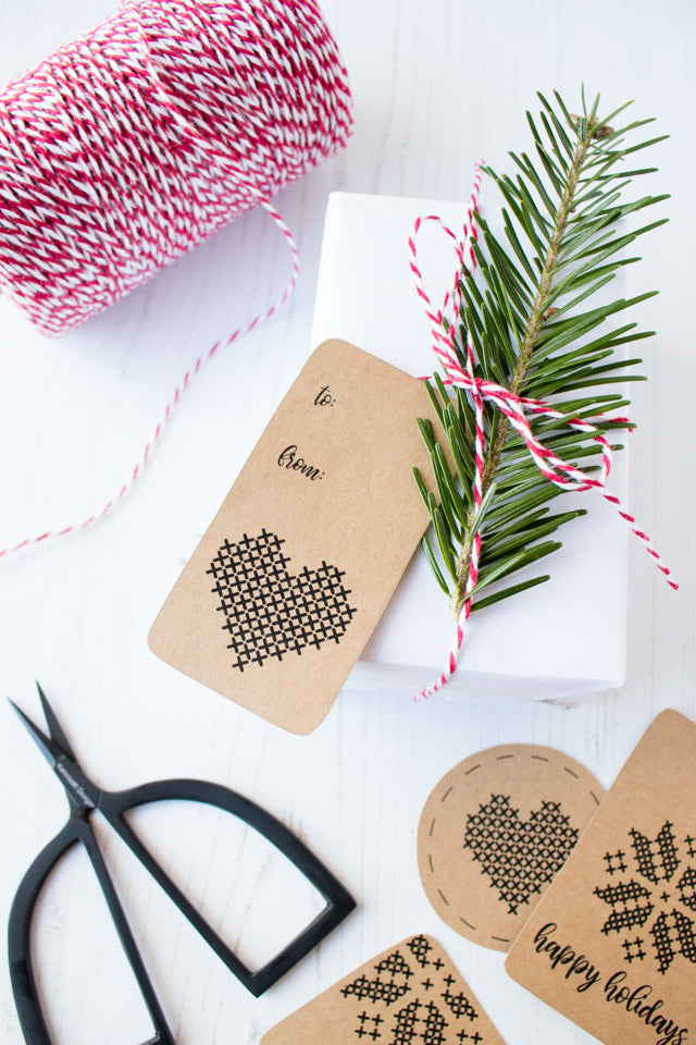 Free printable cross-stitch inspired holiday gift tags