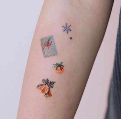 It's Giving Tuesday, So We're Giving You Holiday Tattoo Ideas