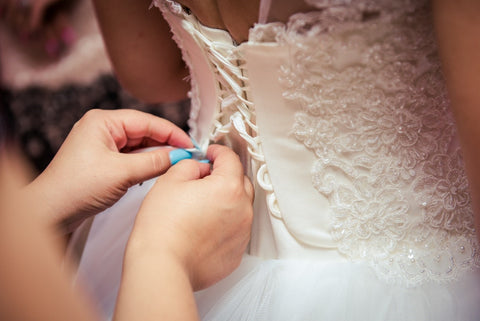 Your tailor can show a friend or family member how to lace your corset