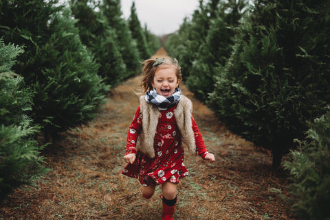 toddler-red-dress-running-outside-christmas-farm