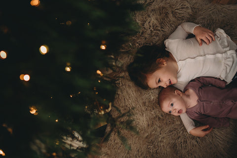 sisters under christmas tree easy diy photo shoot ideas from white loft home blog