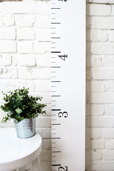 Building a neutral nursery with this farmhouse white growth chart