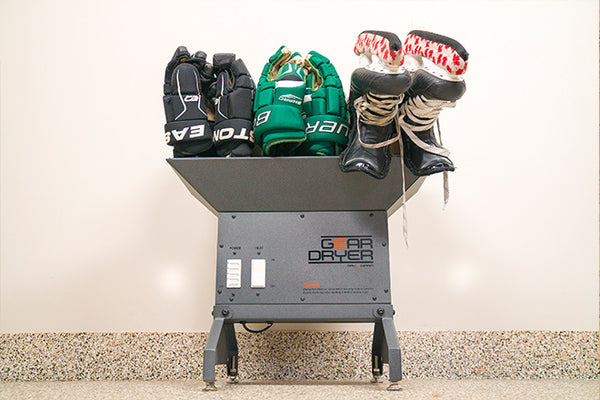Freestanding GearDryer drying hockey skates, drying hockey gloves, and hockey gear