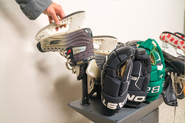 Freestanding GearDryer drying hockey skates and drying hockey gloves