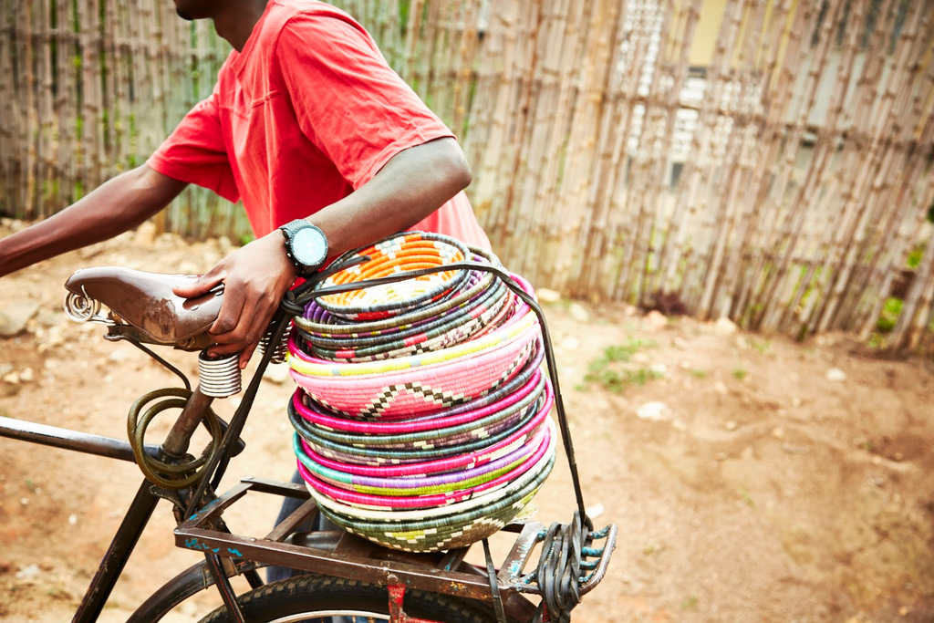 Artisan carrying baskets on his bike