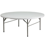 This round folding table is 6 feet long and is beneficial in a multitude of settings that include banquet halls, conference centers, cafeterias, schools and in the home. The table can be used as a temporary seating solution or be setup for everyday use. The bi-fold feature folds the table in half the size and includes a carrying handle for easy transport. The durable blow molded top is low maintenance and cleans easily. The table legs fold under the table to make storage more convenient and for better porta