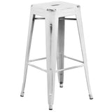 This distressed stool will add a modern industrial appearance to your home or work space. This space-saving stool is stackable making it great for storing. A cross brace underneath the seat adds extra stability and features protective caps that prevent the finish from scratching when stacked. The frame is designed for all-weather use making it a great option for indoor and outdoor settings. For longevity, care should be taken to protect from long periods of wet weather. The legs have protective plastic feet