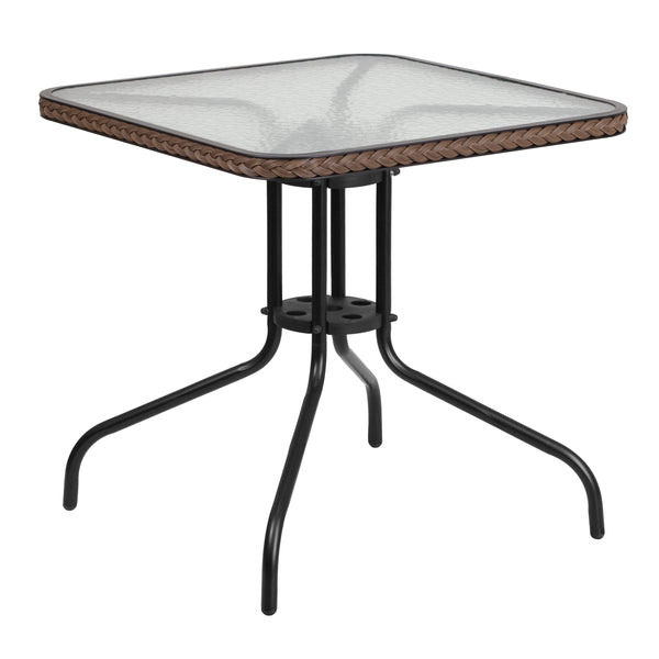 Create the perfect relaxing or entertainment environment with this patio table. This glass table will enhance your bistro, cafe, restaurant, hotel or home patio space. The ripple designed table top features a smooth surface for keeping items level. The designer rattan edge band adds an appealing touch. The table was designed for all-weather use making it a great option for indoor and outdoor settings. For longevity, care should be taken to protect from long periods of wet weather.