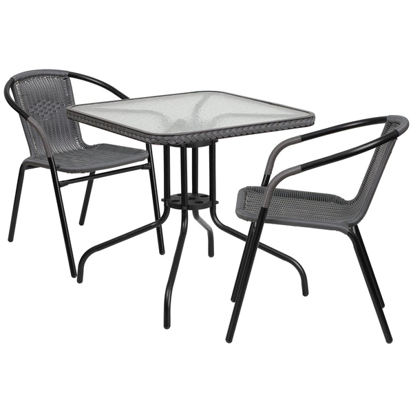 Arrange your perfect outdoor space with this glass table set. This set will enhance your bistro, cafe, restaurant, hotel or home patio space. The rippled designer glass top has a smooth surface for keeping items level. The rattan edge band adds just the right touch to set it apart. The lightweight chair features a curved back, and a comfortable rattan seat. For easy storing and cleaning purposes these chairs stack up to 23 chairs high. This set was designed for all-weather use making it a great option for i