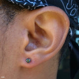 Earlobe piercing by Zach