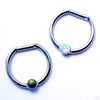 Hinged Ring with Bezel-set Gemstone in Titanium from Intrinsic with Black Opal & White Opal