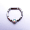 Hinged Ring with Bezel-set Gemstone in Titanium from Intrinsic with White Opal