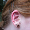 Three Outer Helix piercings with Ball Press-fit End in Titanium from NeoMetal in 1/8