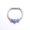 Hinged Ring with Three Bezel-set Gemstones in Titanium from Intrinsic with Arctic Blue