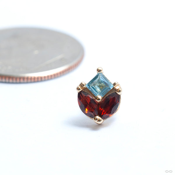 Bloom Press-fit End in Gold from Quetzalli with garnet & sky blue topaz