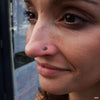 Nostril piercing with Double Millgrain Marquise Press-fit End in Gold from LeRoi in Black CZ