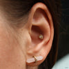 Conch piercing with Double Millgrain Pear Press-fit End in Gold from LeRoi in Clear CZ