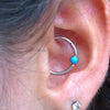 Daith piercing with Captive Gem Bead in Titanium from Industrial Strength in Turquoise