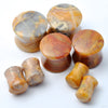 Crazy Lace Agate Double-Flare Plugs from Oracle in Assorted Sizes