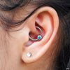 Daith piercing with Captive Gem Bead in Titanium from Industrial Strength in Mint CZ