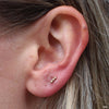 Lobe Piercing with Linear Tri Bead Press-fit End in Yellow Gold from BVLA