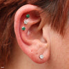 Three outer helix piercings with Prong-set Gemstone Press-fit End in Titanium from NeoMetal in 4mm Clear CZ & Emerald