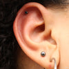 Outer helix piercing with Prong-set Gemstone Press-fit End in Titanium from NeoMetal in 2.5mm Black