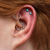Two outer helix piercings with Bezel-set Cabochon Press-fit Ends in Titanium from NeoMetal with 4mm & 3mm turquoise