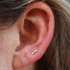 Lobe Piercing with 2 Dots 1 Bar Press-fit End in Gold from Pupil Hall