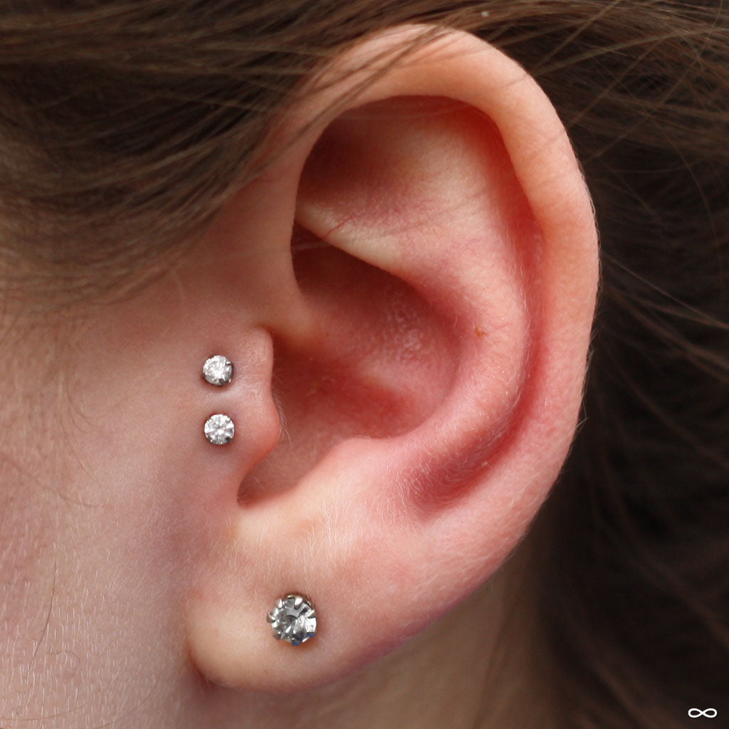 7749c62a2 Double tragus piercings by Andru