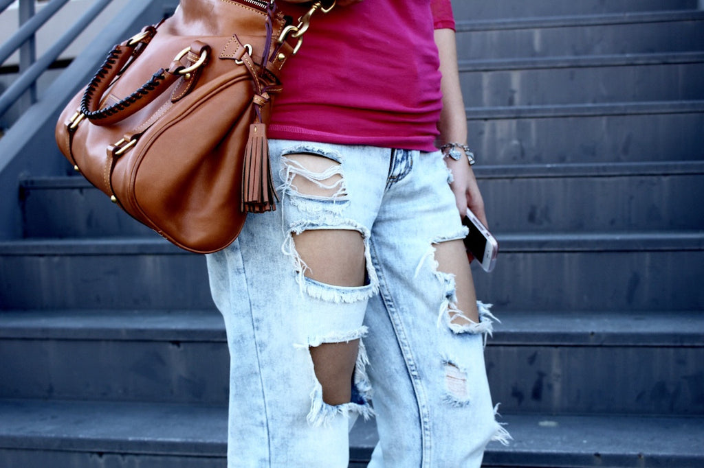 distressed jeans | brown cross body