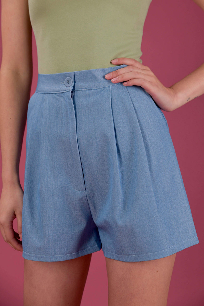 AWE Bottoms EVERYDAY PLEAT HIGH-WAIST SHORTS IN LIGHT DENIM