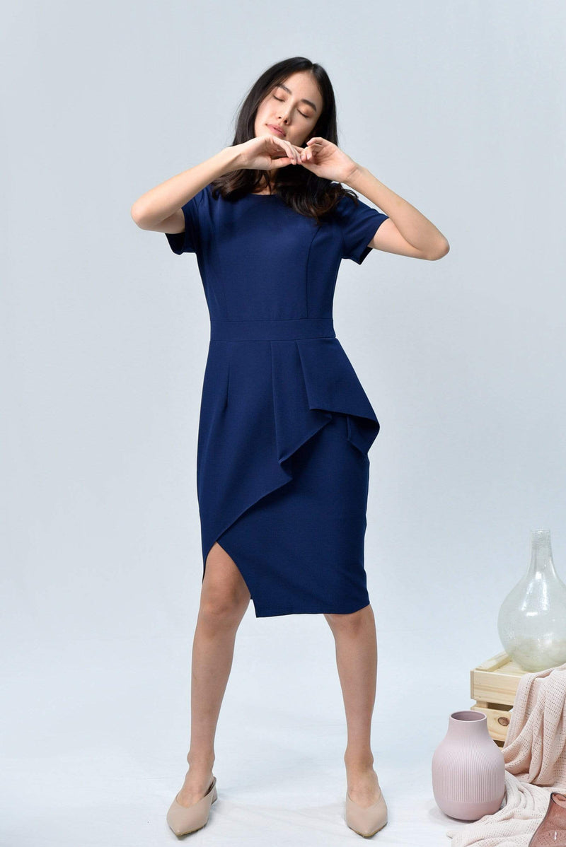 AVA NAVY SLEEVED PEPLUM DRESS