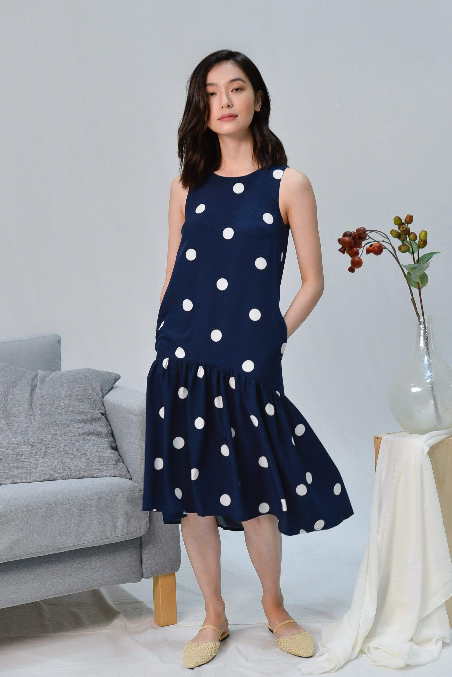 LANA NAVY POLKA DOT DIP-HEM DRESS