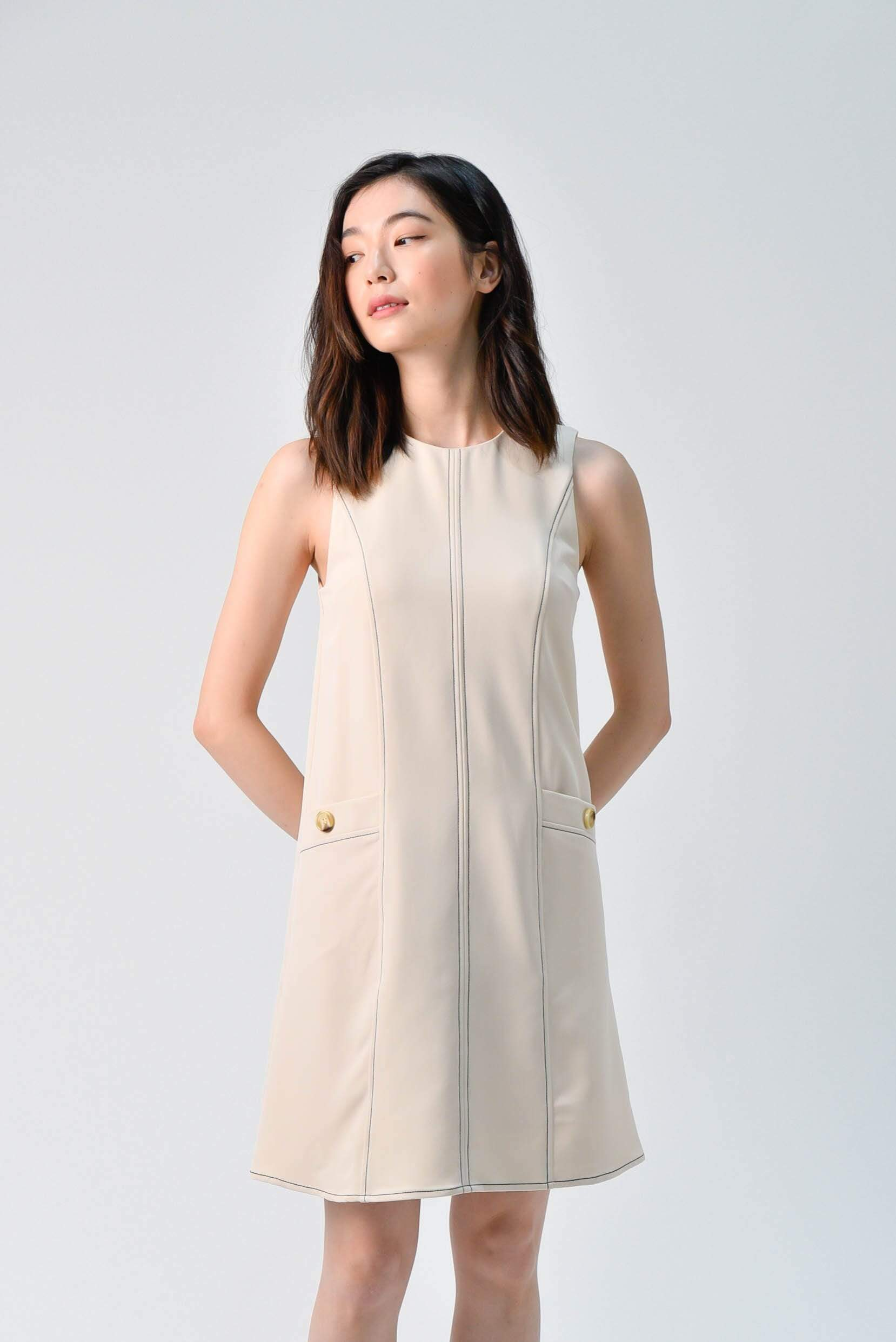 STITCHED SHIFT DRESS IN BEIGE
