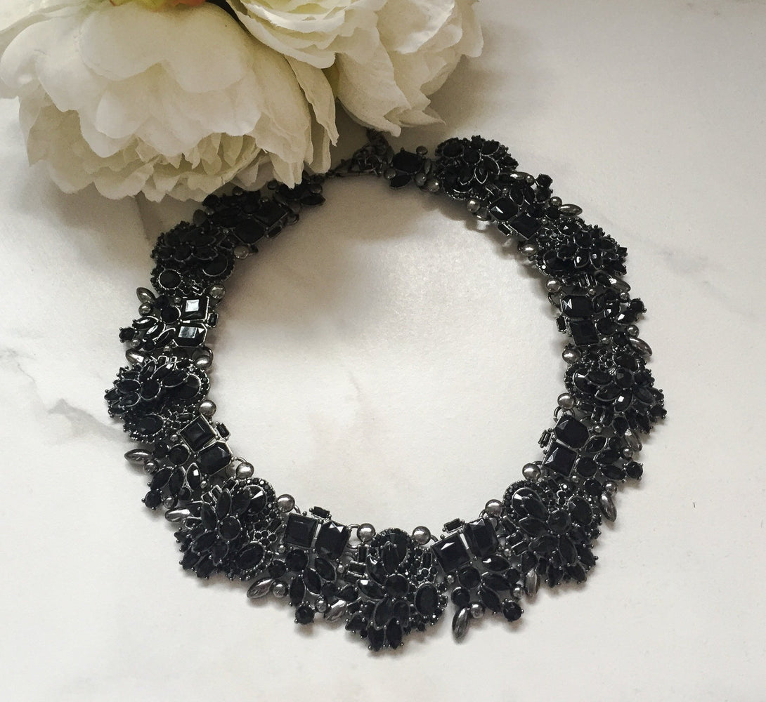 black statement necklace with rhinestones and jewels