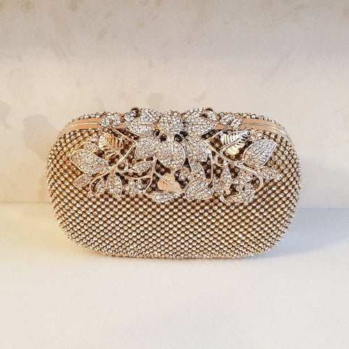 Womens gold embellished clutch bag