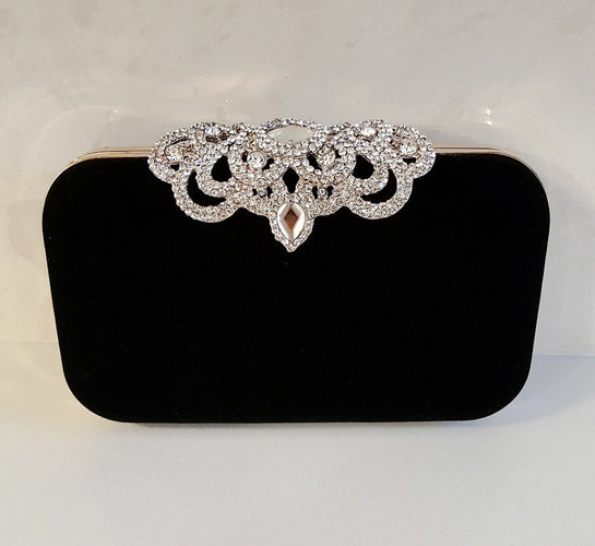 black suede clutch bag with embellished rhinestone clasp and gold chain