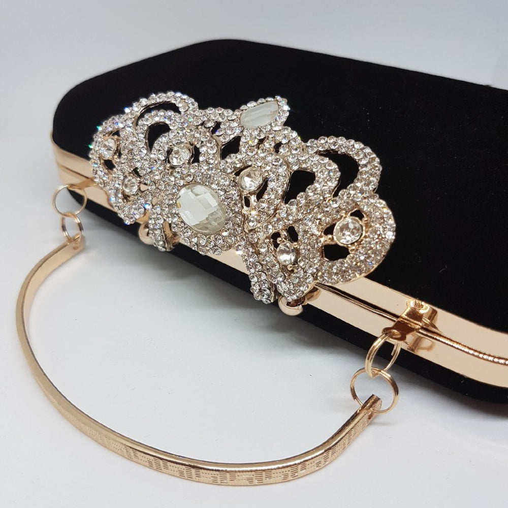 gold handle black clutch bag